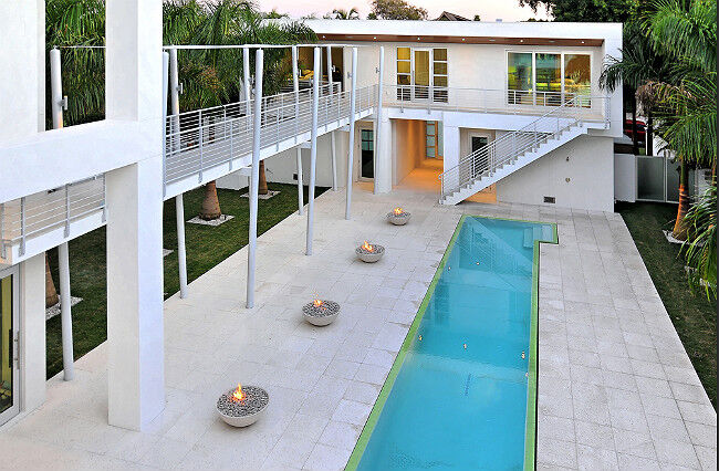 Top View of Kingsman Fire Bowls Next to Pool