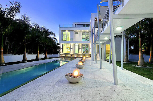 Front View of Kingsman Fire Bowls Next to Pool