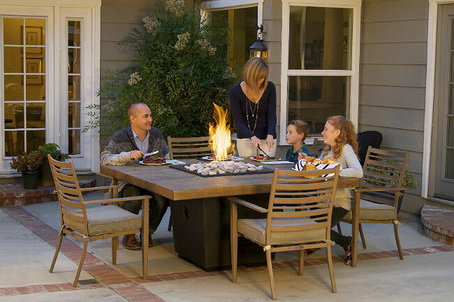 Family Dining at a Fire Table