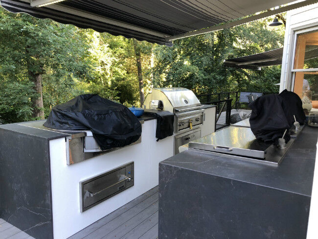 Gray and white outdoor kitchen island with drop-in cooktop and grill