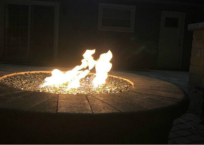 Close-up of flames in a fire pit at nighttime
