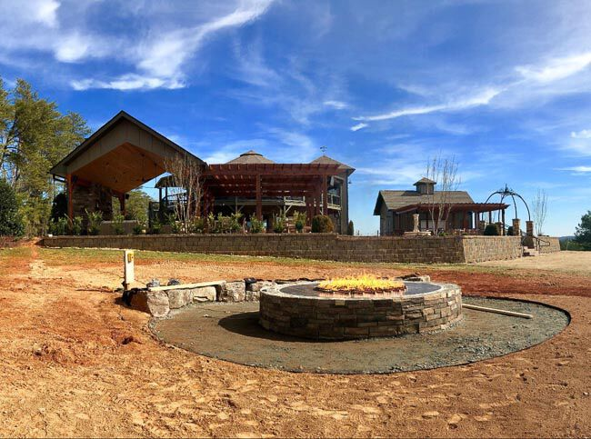 Unfinished fire pit in front of a covered patio